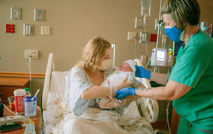Nurse with mom and baby