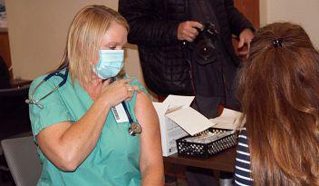Dr. Jennifer Heinicke receives COVID-19 vaccine
