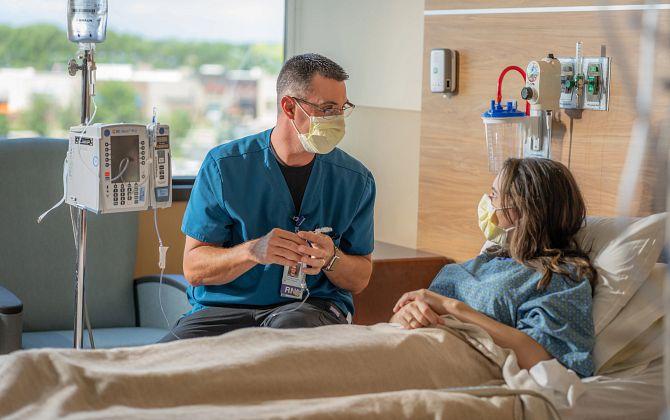 Nurse at patient bedside
