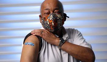 Senior, male, getting COVID-19 vaccine