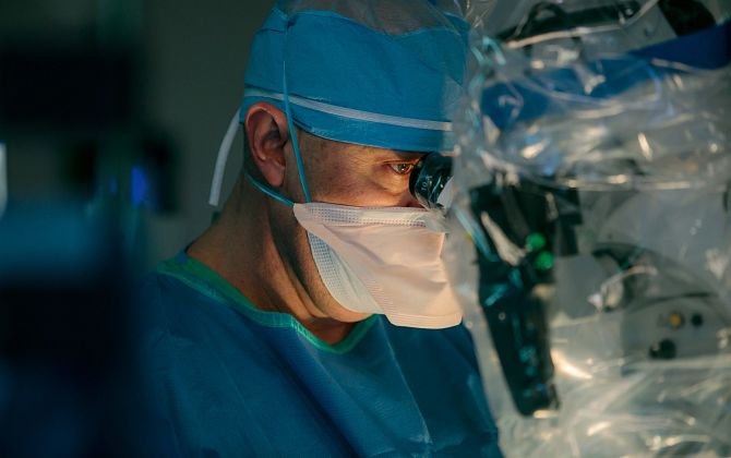 Doug Orndorff, MD, with team, perform a spinal surgery on a patient in an operating room at Mercy Regional Medical Center in Durango, Colorado, U.S.