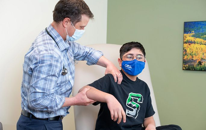 Dr. James Ford sees a young patient at High Country Healthcare in Silverthorne, Colorado, March 25, 2021.