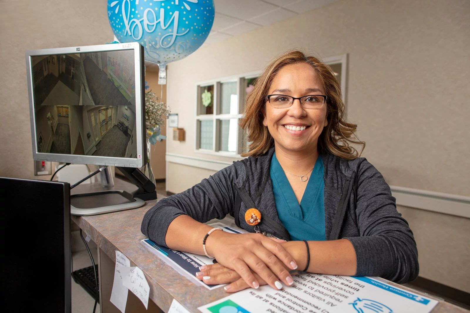 Manager of Clinical Nursing, Veronica Flores, shares a smile in the birth center at St. Catherine Hospital, Garden City, KS.