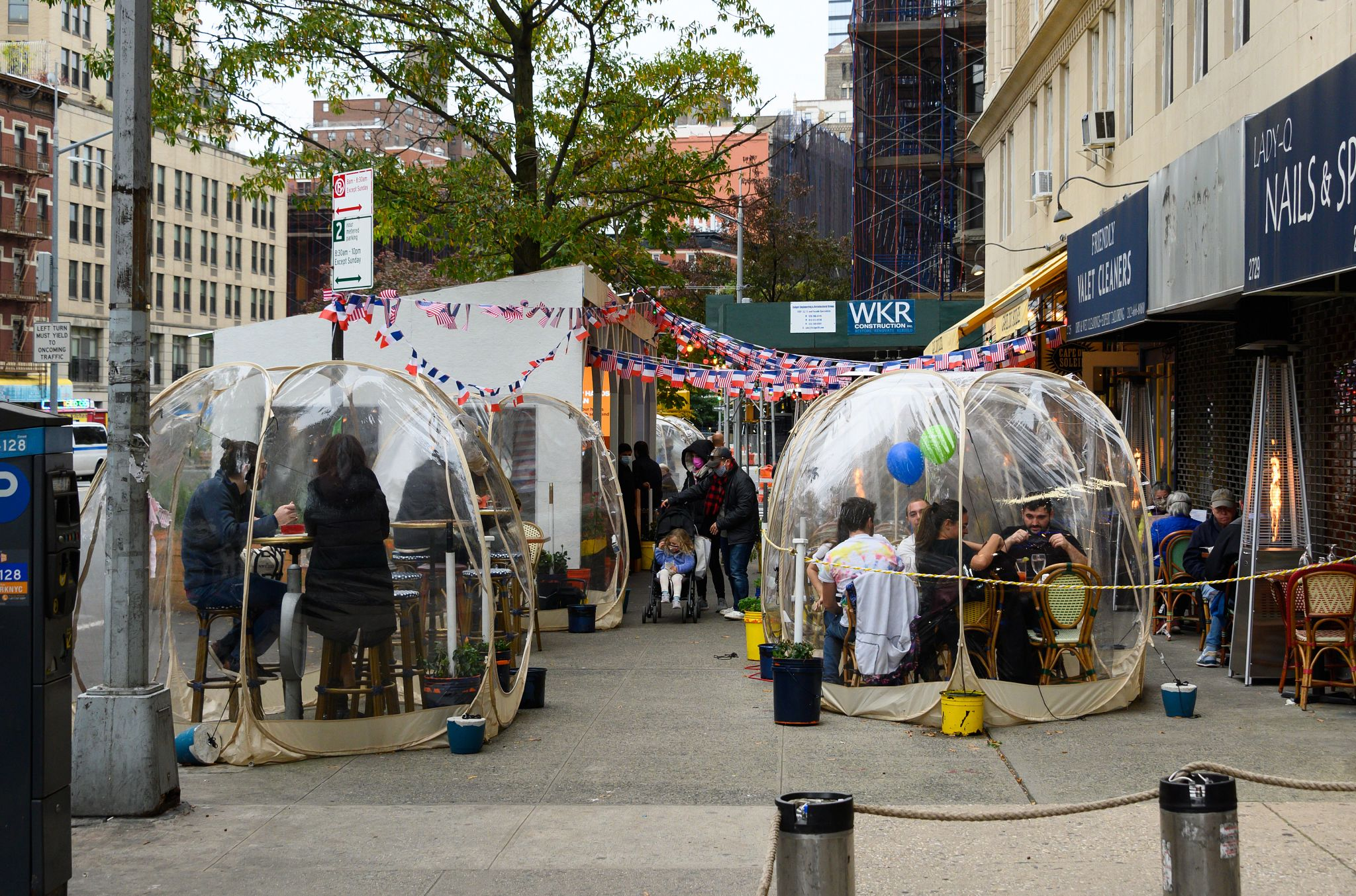 People dine in social-distancing bubble tents at the Cafe Du Soleil restaurant on the Upper West Side as New York City imposes restrictions to slow the spread of coronavirus. (Noam Galai/Getty Images)