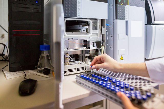 Laboratory scientist prepares samples for download to High-performance Liquid Chromatograph Mass Spectrometr.