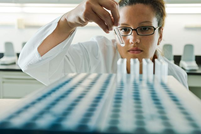 Lab technician looking at test tube used for gel-clot LAL assay