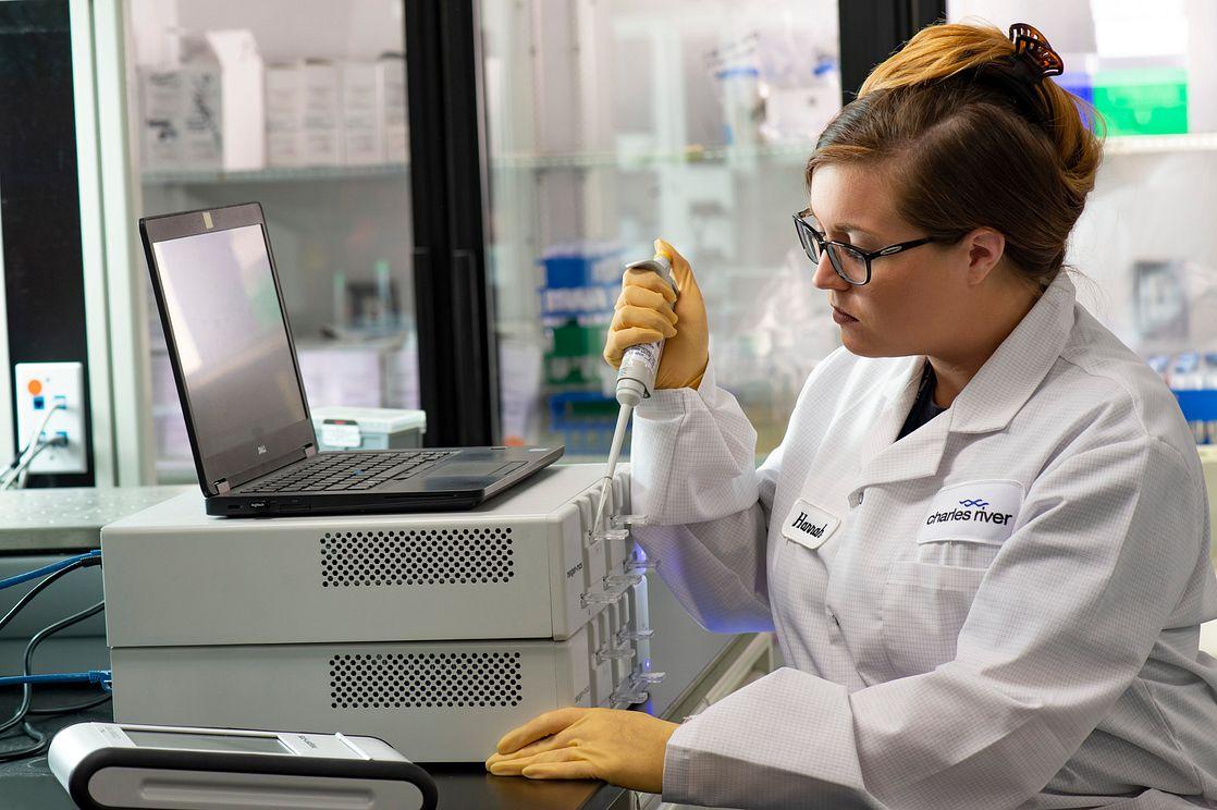 QC lab technician performing endotoxin testing with the Endosafe nexgen-MCS cartridge technology instrument