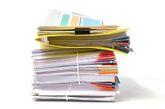 stack of white and colored documents isolated on a white background