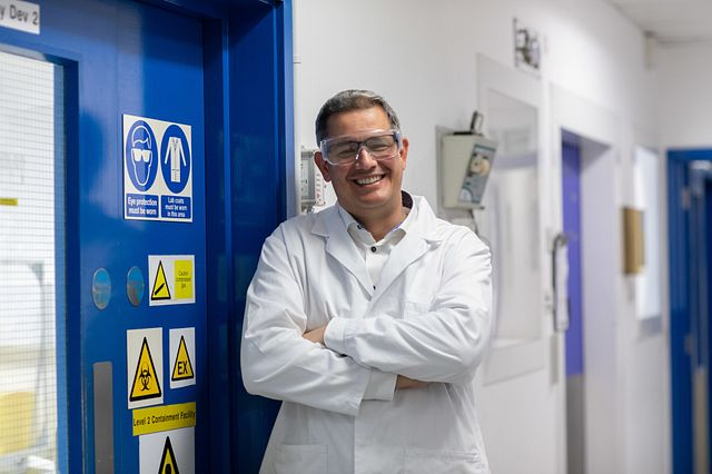 Image of Omar Aziz, a biologist who develops cell-based assays to test the efficacy of compounds for drug development.