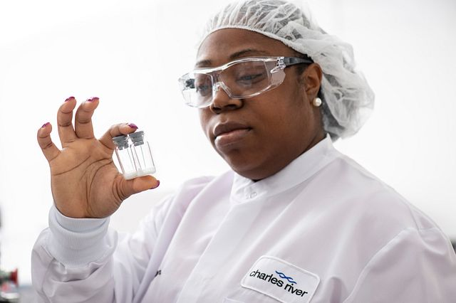 Endosafe lal manufacturing technician holding two vial bottles in their right hand