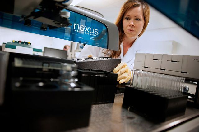 lab technician using Charles River Nexus solution
