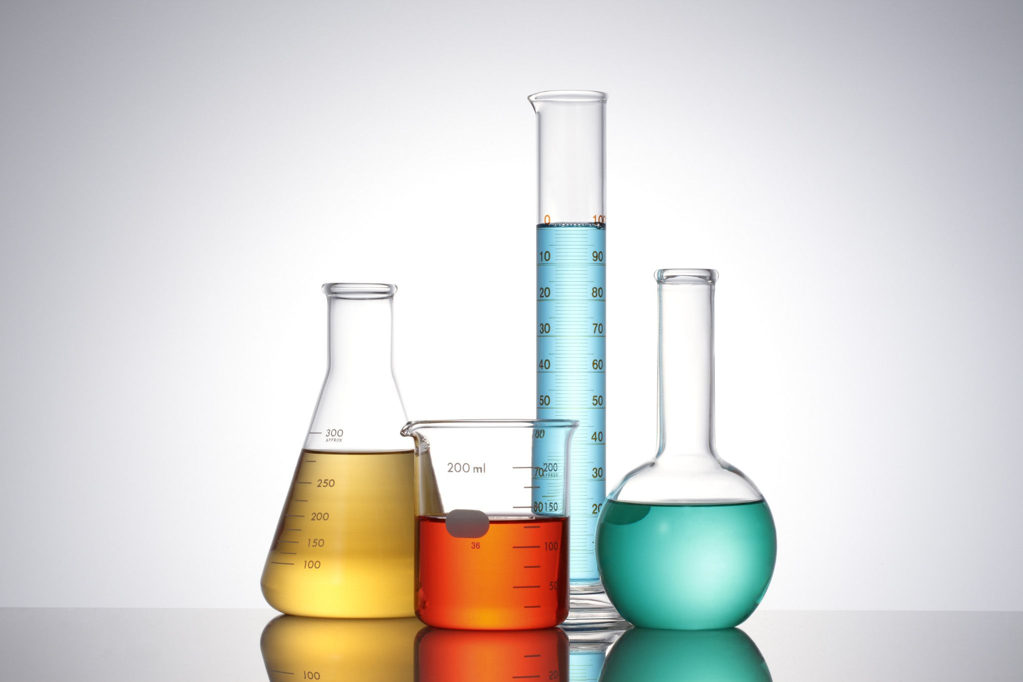 Photo of different size and shaped beakers with colored liquids used in REACH services.