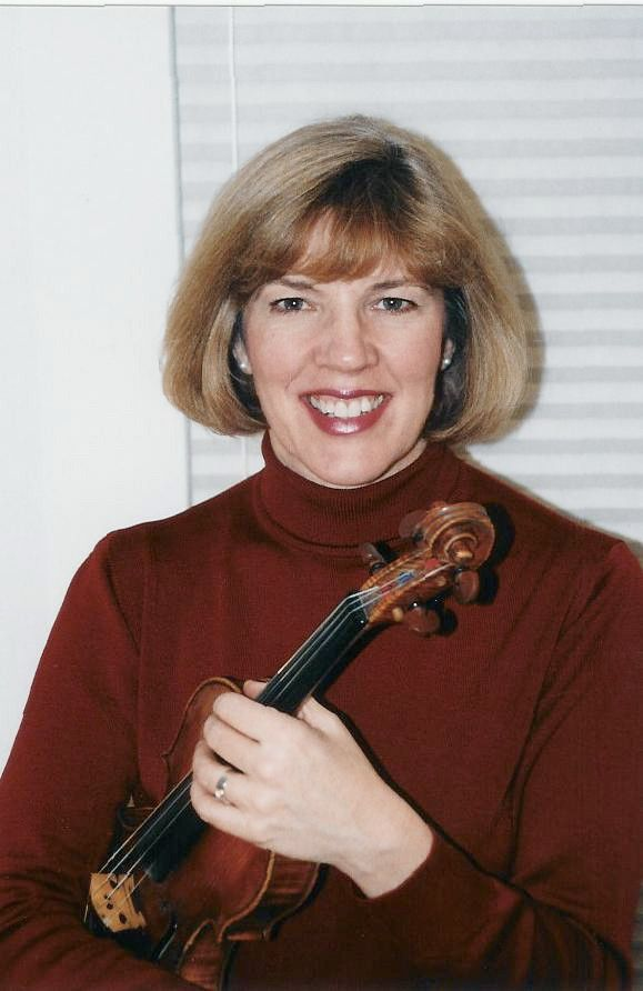 Kathleen Spring holding a violin