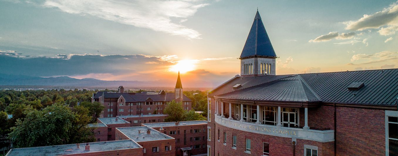 DU campus rooftops at sunset