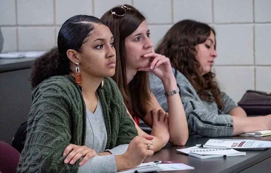 women sitting in class