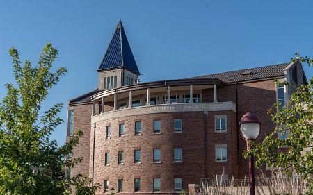 DU building against a bright blue sky