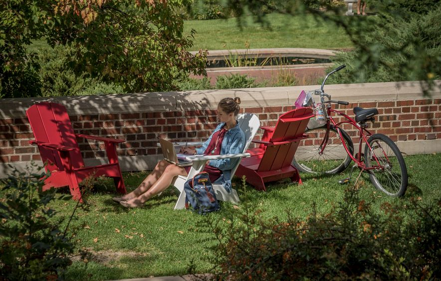 Student studying outside on the Denver campus.