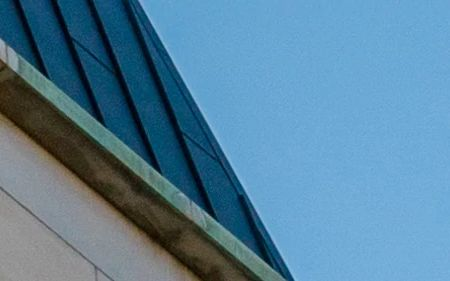 background image of ritchie center steeple at DU campus