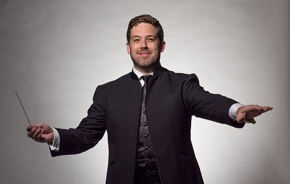 Brett Mitchell conducting