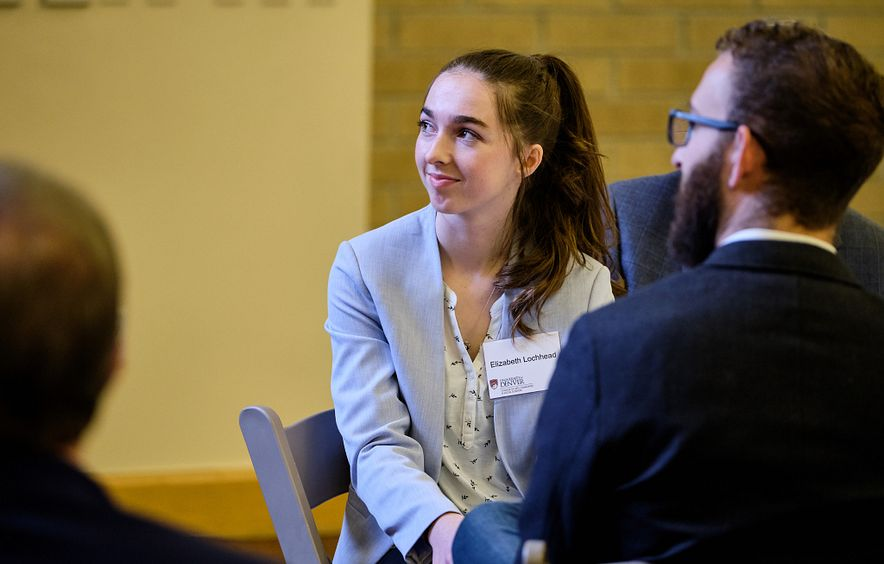 scholarship-winning student smiling at economics scholarship event