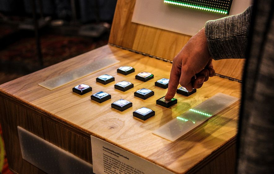 finger pressing buttons