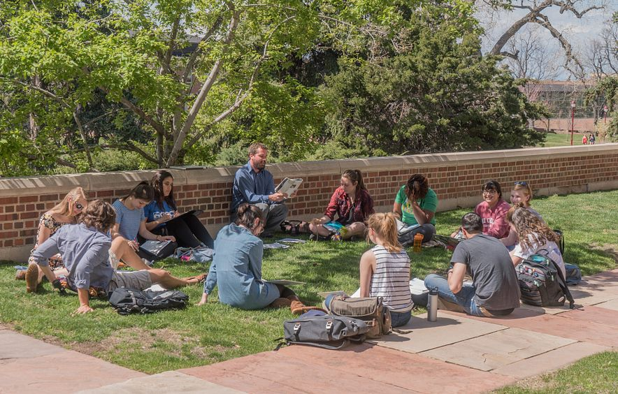 students attending class outside on the DU campus