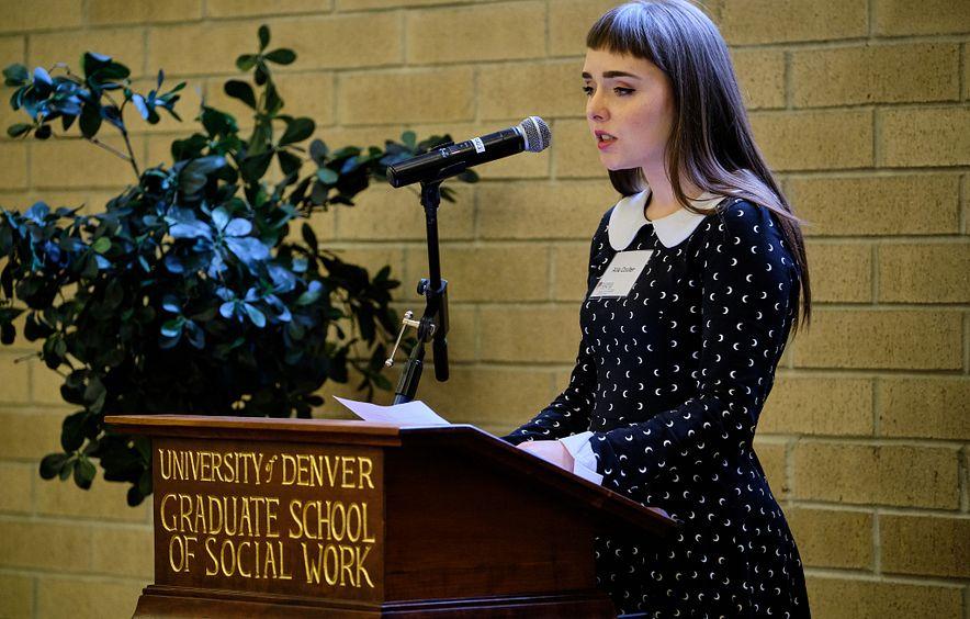 du economics scholarship winner speaking at podium