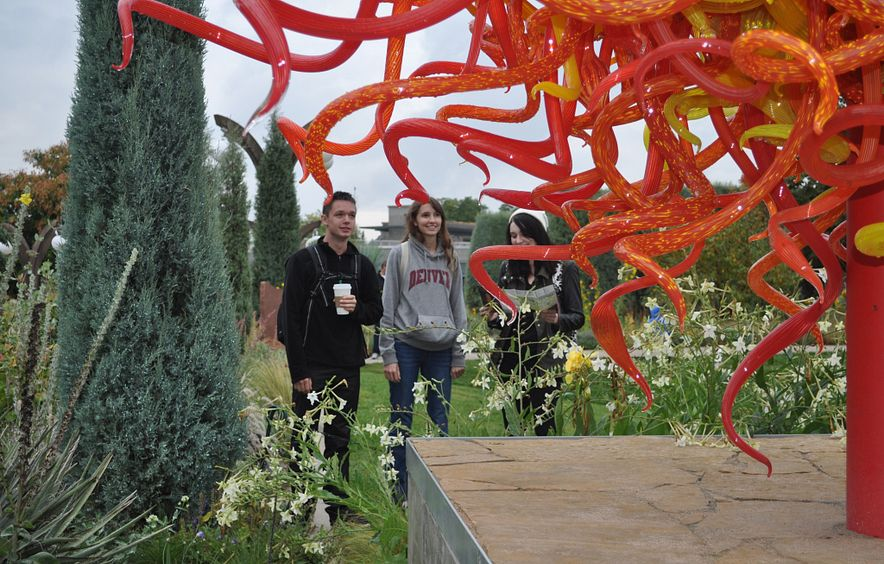 Undergraduate students take a class trip to view Chihuly art at the Denver Botanic Gardens.