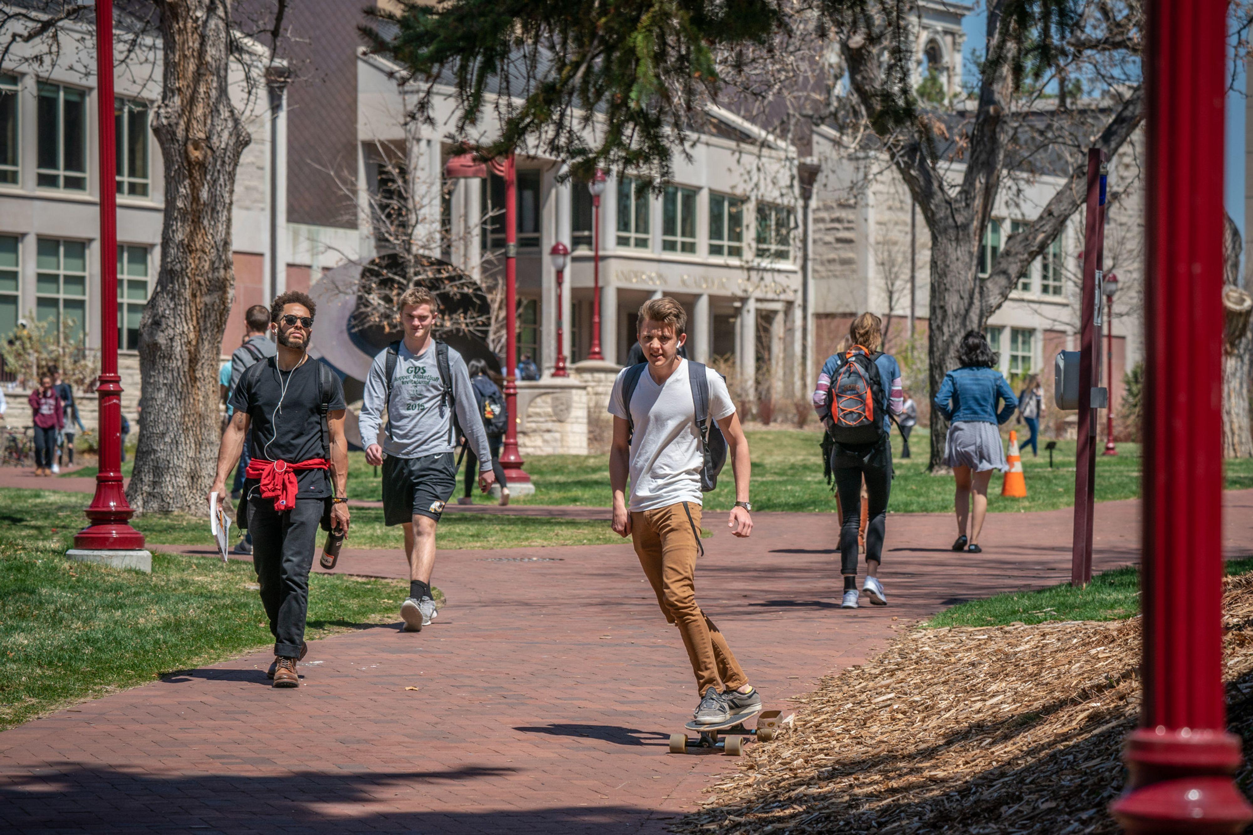 students walking across DU campus