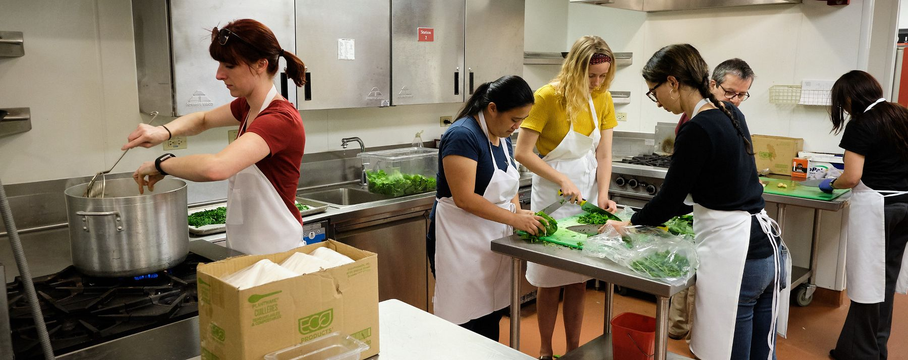 Spanish and Sociology & Criminology students and faculty participate in a Casa de Paz Cook-in
