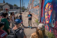 Students learning about mural