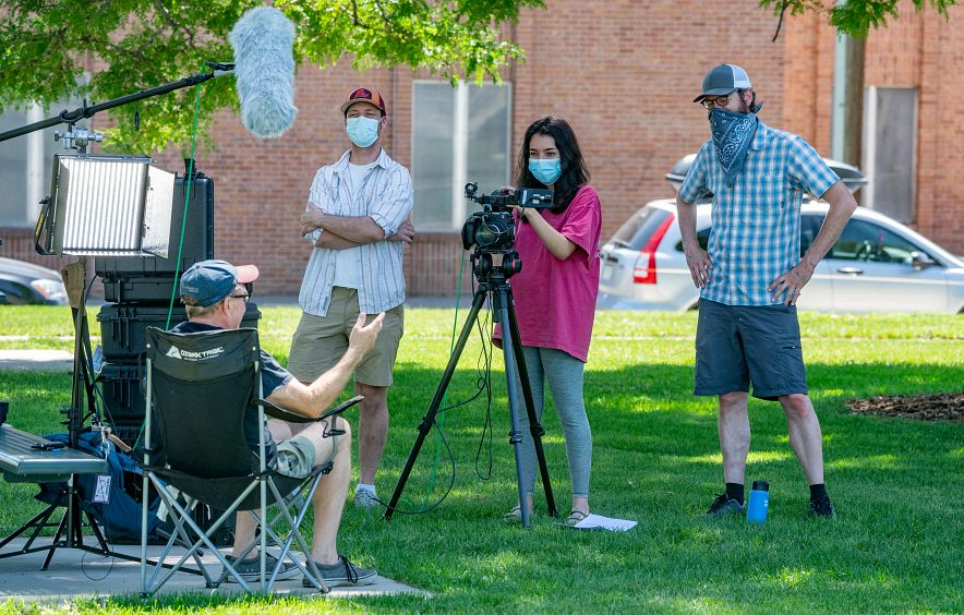 Students film for an environmental documentary course.