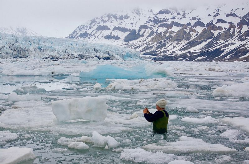 Mia Mulvey Wades in the Arctic Waters