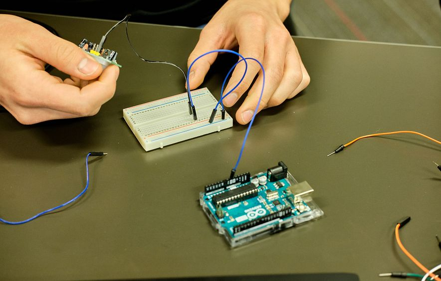 DU EDP student works on circuit board