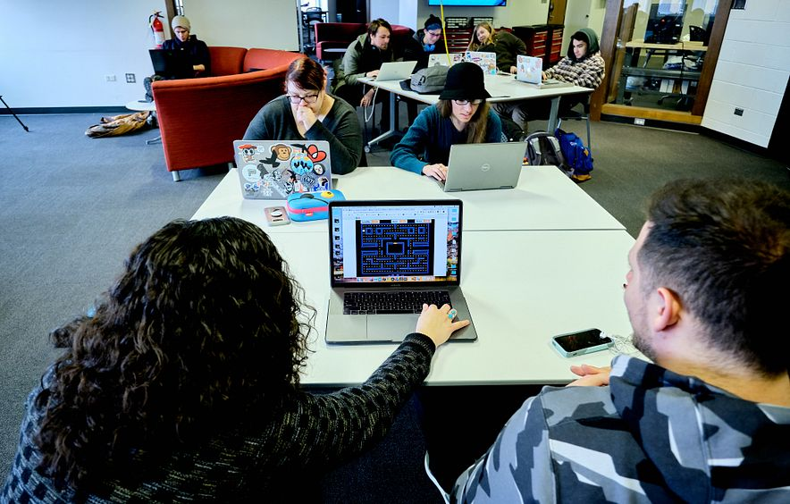 students working together using laptop