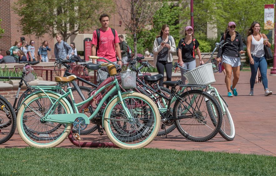 student with a bike