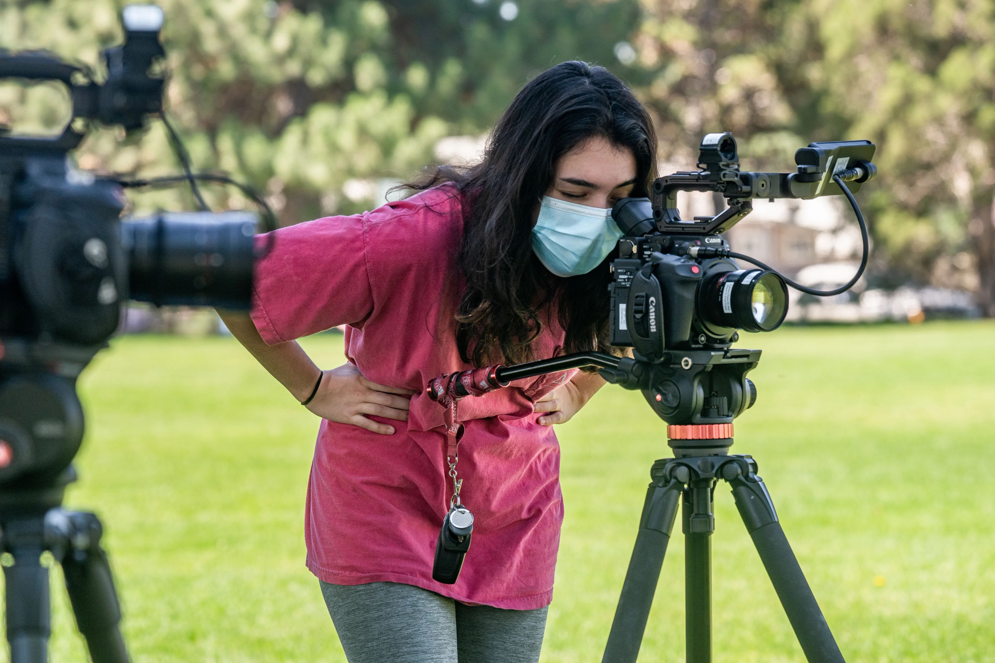 Photo of DU student filming outdoors