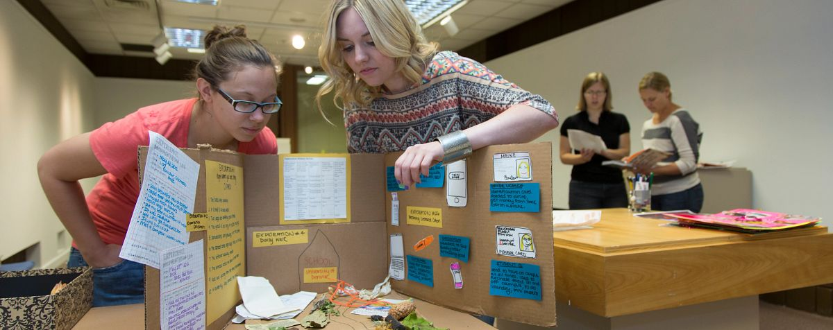 anthropology students setting up exhibit display