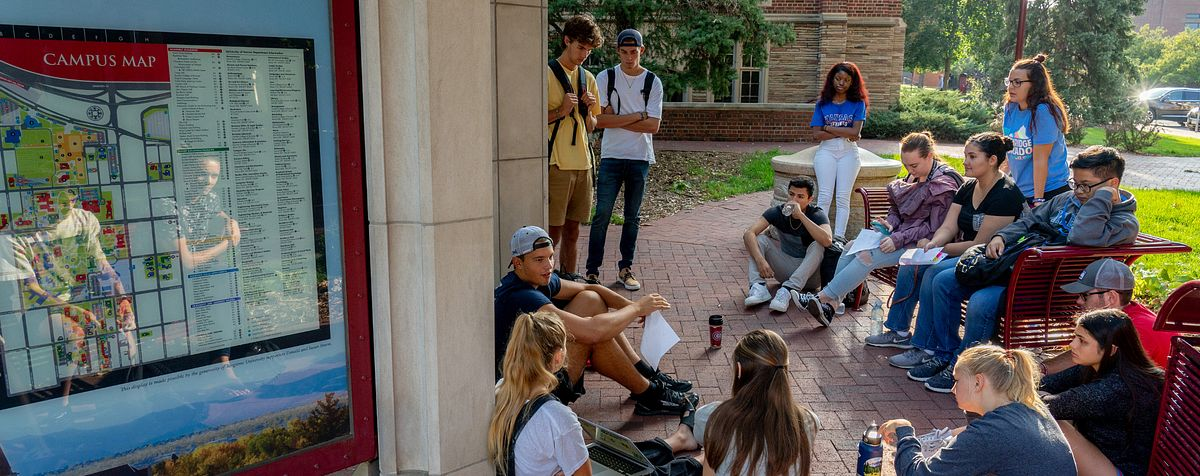 students sitting in a group outside