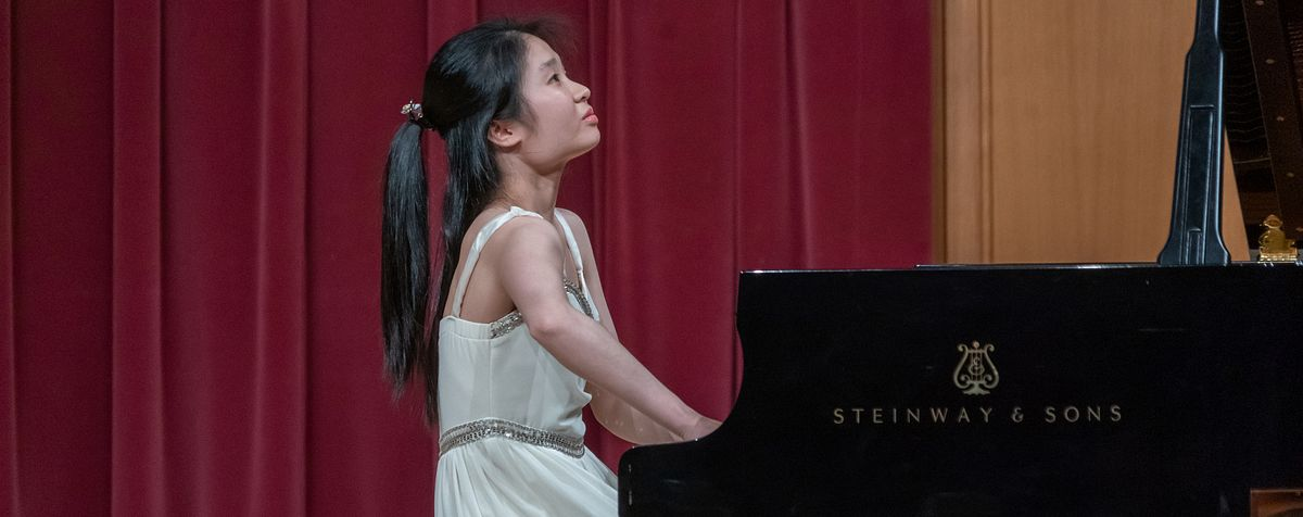A piano student performs.