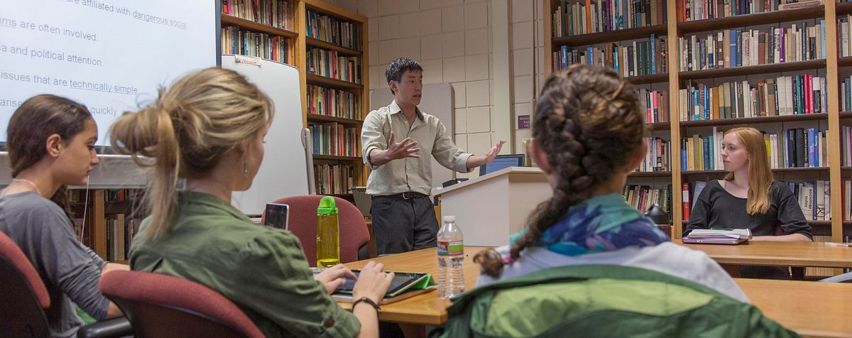 professor Jeffery Lin in front of classroom of students