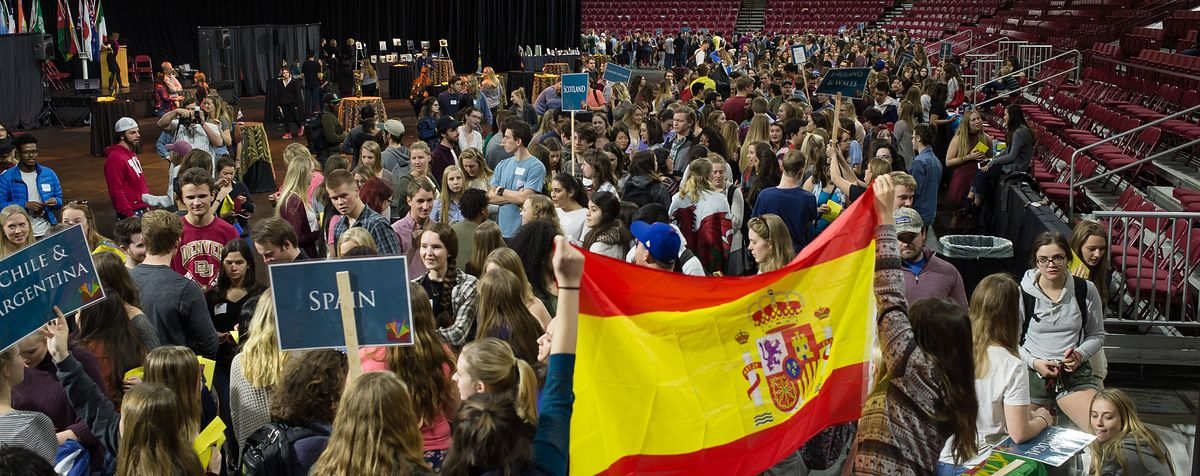 students waving flag at global conference