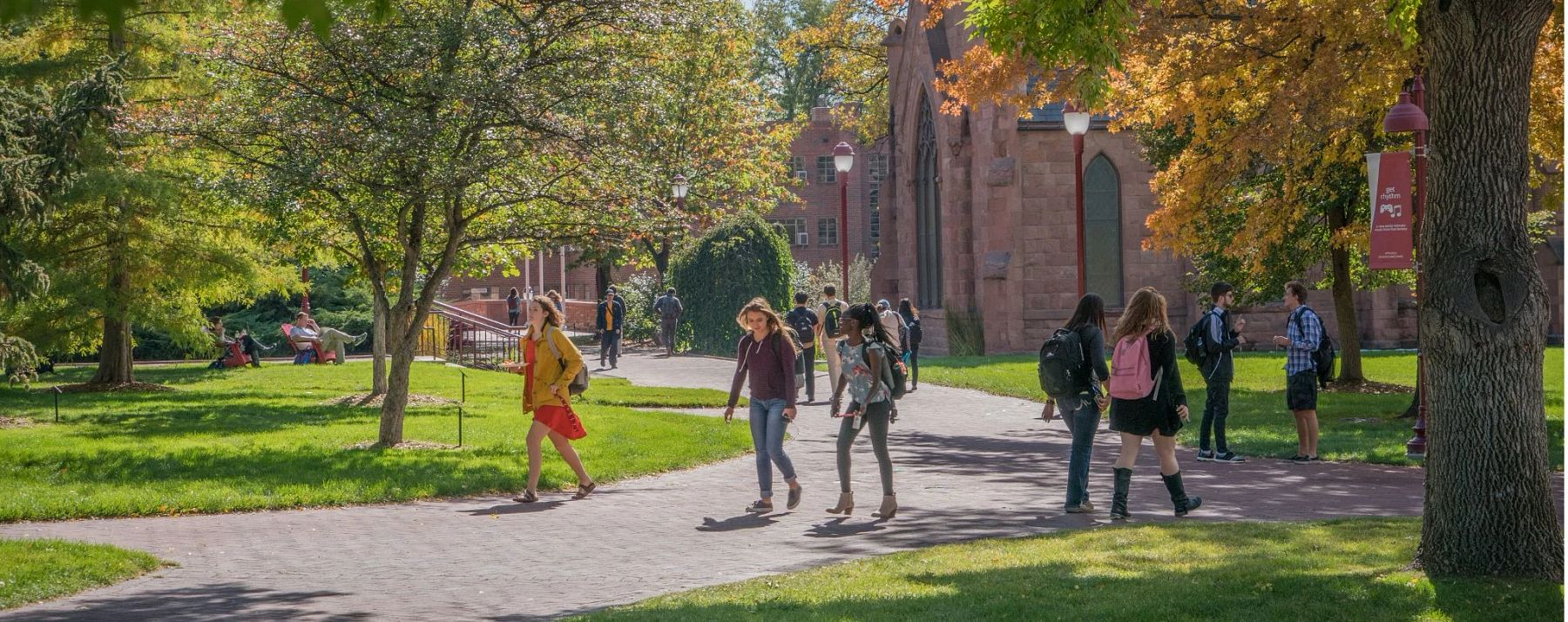students walking across a sunny campus