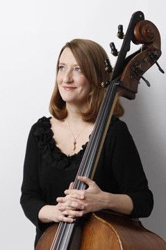 Susan Cahill holding a double bass