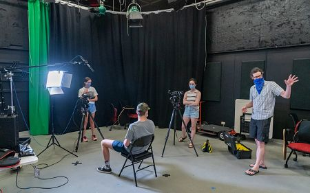 Students filming during a summer course.