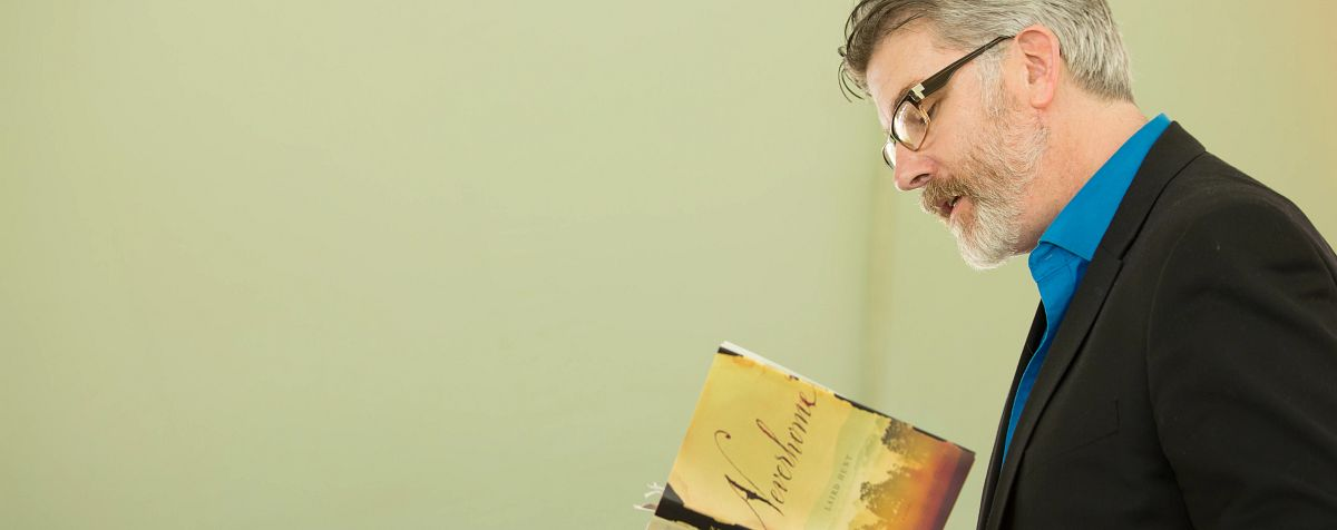 author laird hunt reading book at DU english department event
