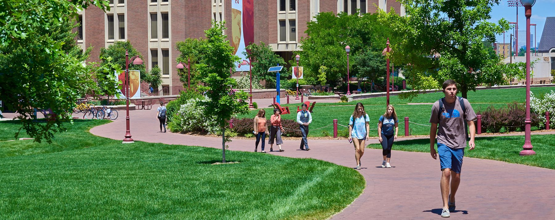 students walking on pathway in front of Sturm Hall