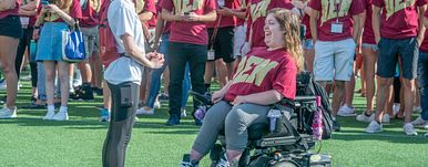 woman in wheelchair at event
