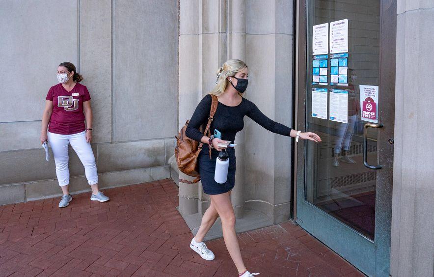 Student walking in building