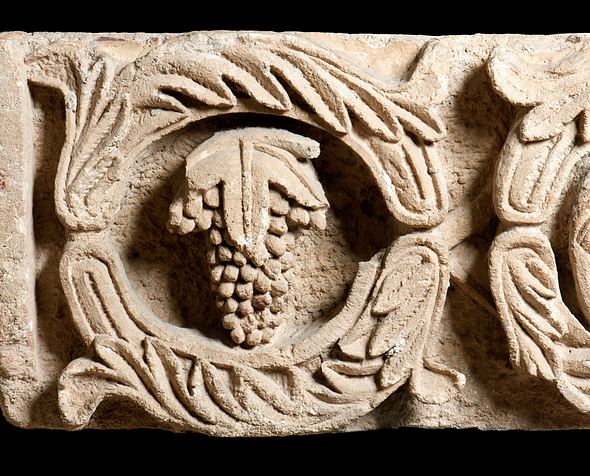 Vine scroll frieze fragment from Period III Altar platform at Khirbet et-Tannur. Retrieved from theartnewspaper. com